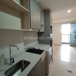 Apartemen Gold Coast studio semi furnish baru