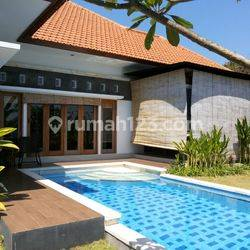 Tropical villa with rice field view